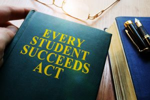Every Student Succeeds Act ESSA on a desk.